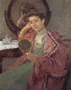 Lady in front of the dressing table