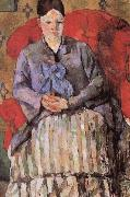 madame cezanne in a red armcbair