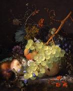 of grapes and a peach on a table top