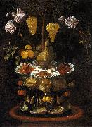 A fountain of grape vines, roses and apples in a conch shell