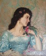 Beautiful pensive portrait of a young woman with a bird and flower