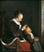 A mother combing the hair of her child, known as Hunting for lice