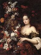 A still life of various flowers with a young lady beside an urn