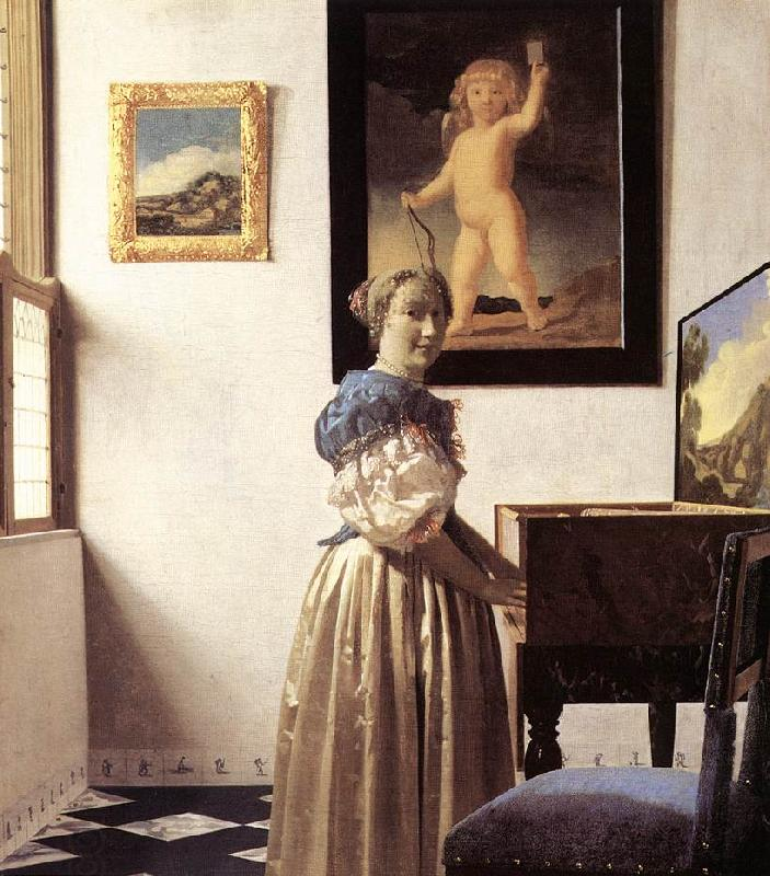 VERMEER VAN DELFT, Jan Lady Standing at a Virginal er